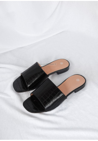Flat black mules with faux croc